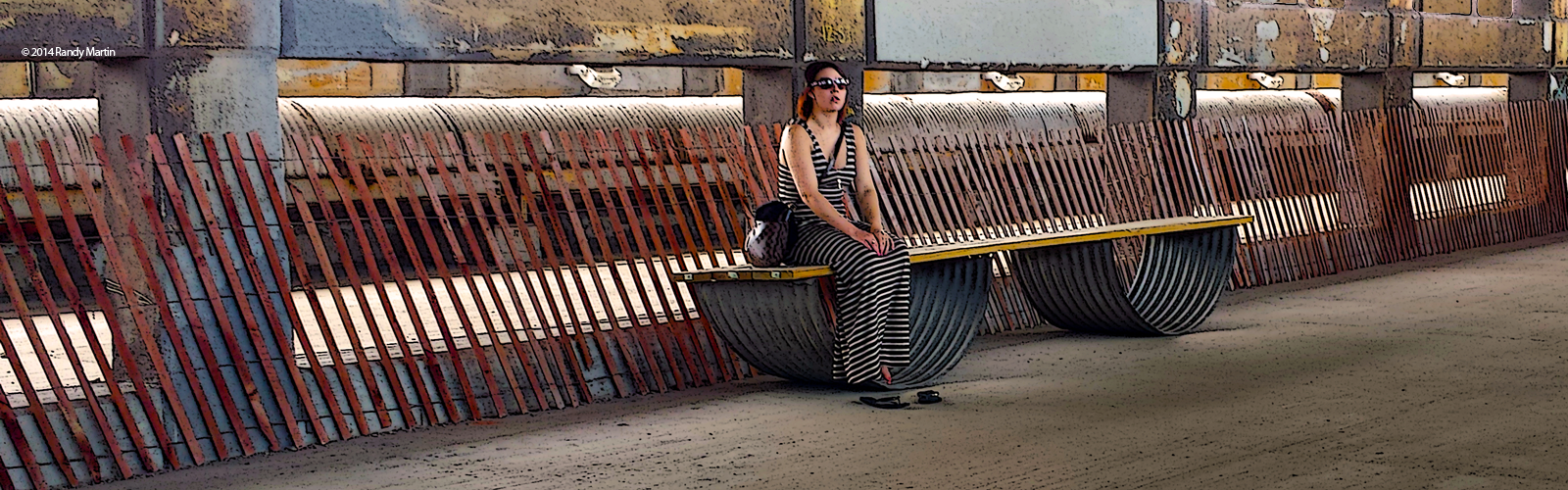 The Lady is The Tiger. Young woman in stripes sitting in front of many stripes.